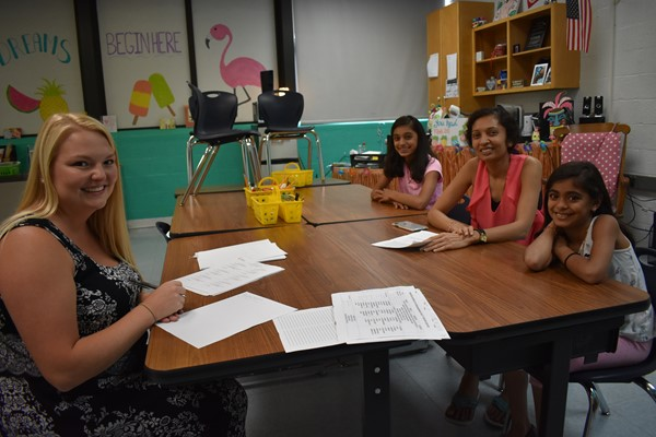 The Patel family meets with teacher in room 119