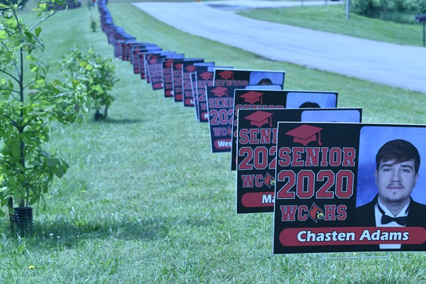 Yard signs representing each senior lined the front of the high school