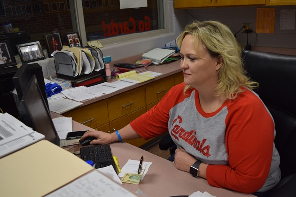 WCHS Receptionist Karen Campbell was receiving calls to transfer to teachers from students