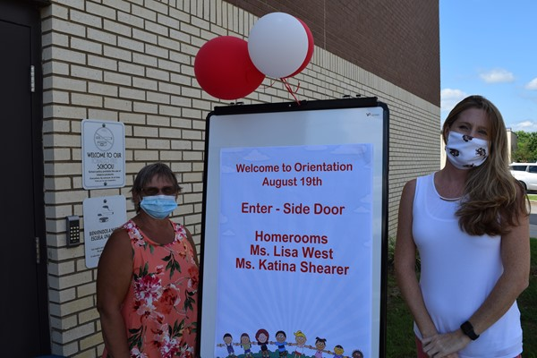 School staff welcome families