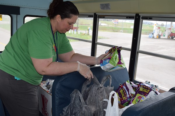 Casey Holt organizes meals along the bus route