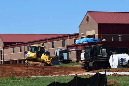 bulldozer and dump truck work on foundation for ATC building