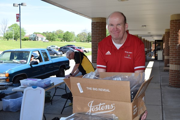 Administrative Asst. Blake Upchurch helped with the distribution process