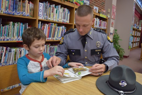 State Trooper assists students in reading program