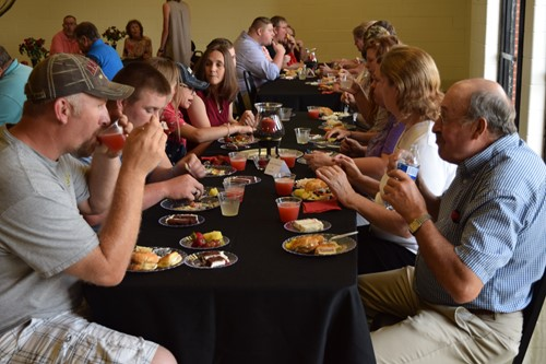 Retirees and their families gathered together for a meal