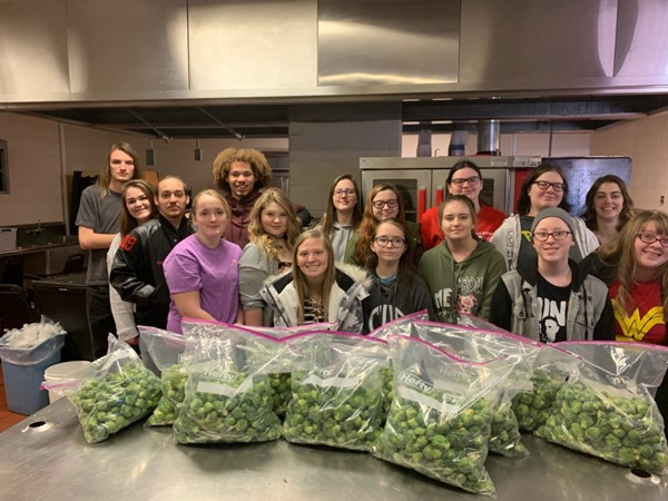 Shannon Foster's class helps package brussel sprouts for cafeterias
