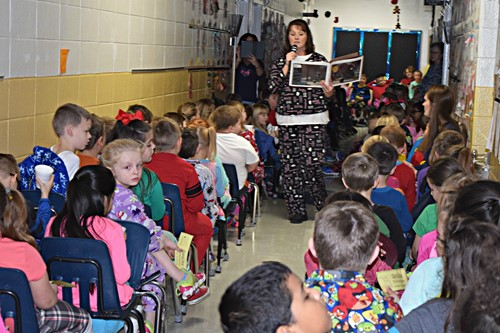 teacher reads the Polar Express to the students