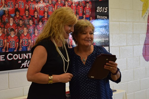 Donna giving a retiree her plaque