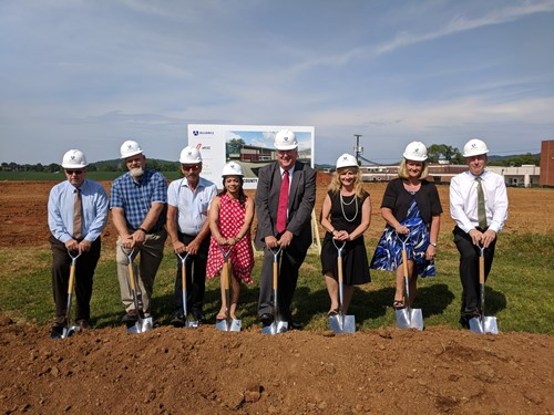 board of education members break ground