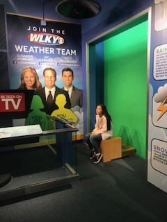 Local student practices being a weather tv reporter
