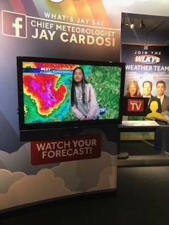 WCMS student on mock tv weather show