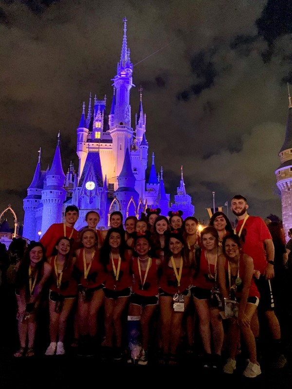 Cheerleaders in front of the castle at DisneyWorld