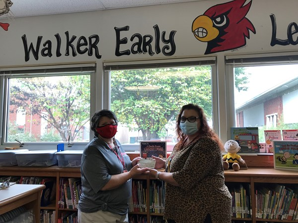 Katherine Kidd presented a check to Walker Early Learning Center Principal Angela Ballinger
