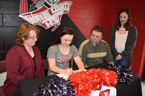 lindsey and parents signing