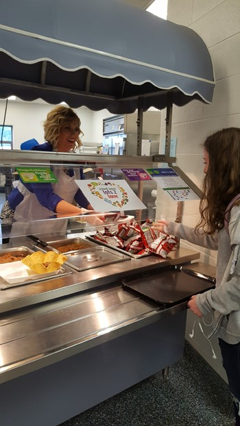 Principal Gossage serving students lunch