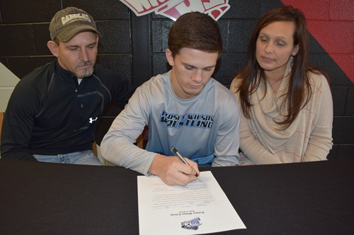 cagen signs with his parents