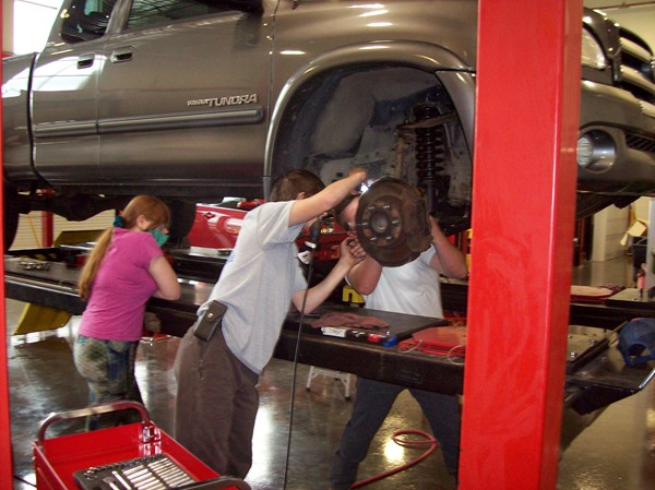 students working in automotive lab