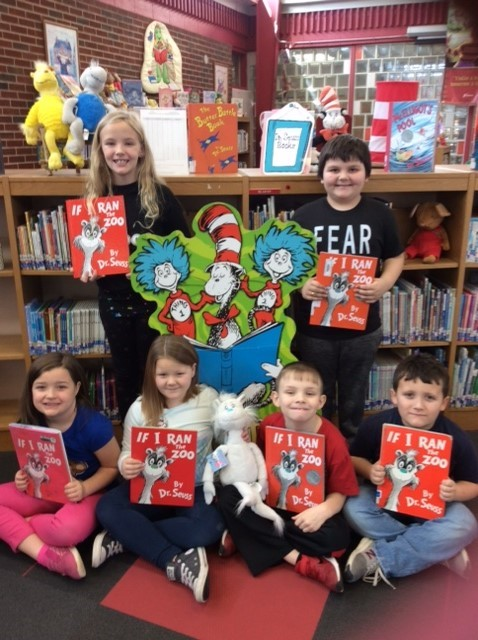 First graders enjoyed a Dr. Seuss book during literacy block