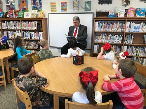Superintendent Wayne Roberts read to students