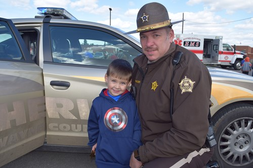 Collin Spencer was happy to see his father Deputy Tommy Spencer during Saftey Day