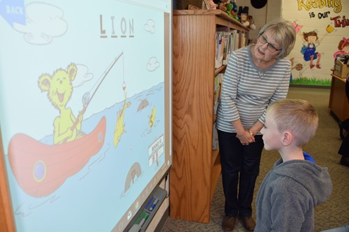 Student plays on smart board