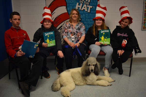 A group photo with winston the Reading the Dog