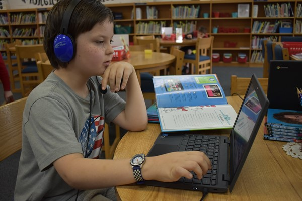 A student working a program designed to help kids with their reading aptitude