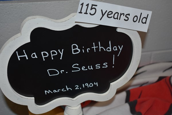 A small sign saying happy birthday to Dr. Suess, even after he is long gone