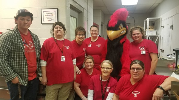 Cardinal with high school staff