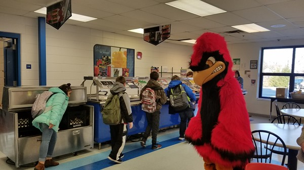 Cardinal having breakfast with the elementary student