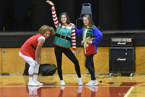 "D'Angelo Dixon, Grayson Roberts, and Makena Hatfield performing their dance routine, ""Santa's Helpers"""