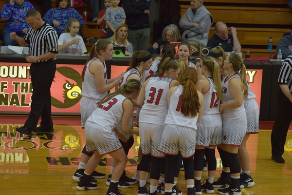 The Lady Cards in a huddle
