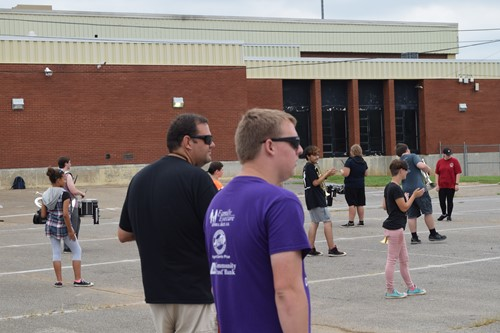Crites and Cook looking at Band Kids marching
