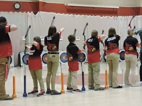Young archers preparing to make a shot