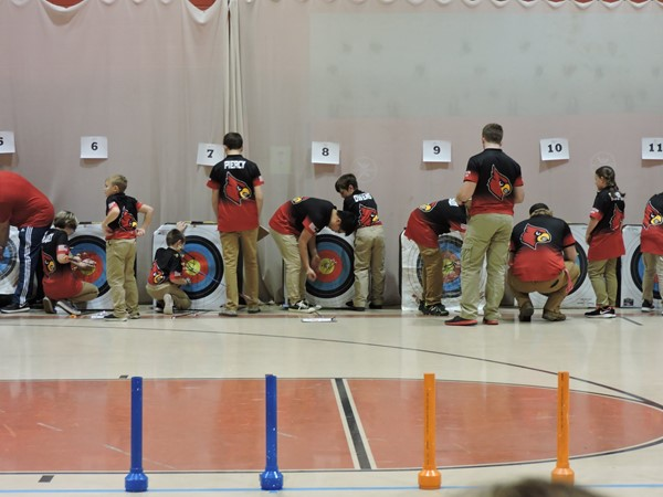 Students receiving their arrows from the targets