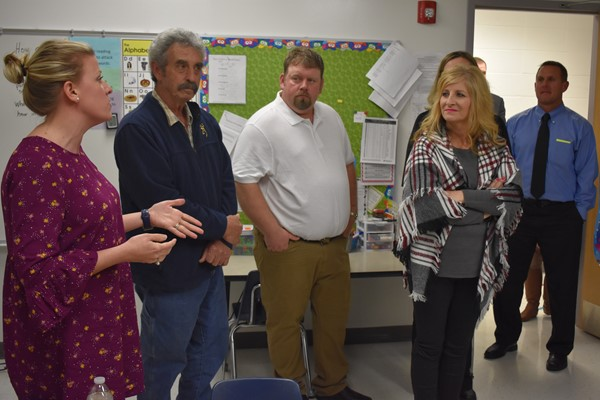 (L-R) Reading Specialist Jessica Hancock  speaking to board members Larry Muse, Jarrod Criswell, and Donna Blevins about literacy block at Bell Elementary