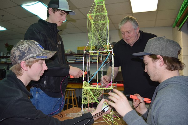 WCHS art teacher Tim Withers (Back right) helping students (L-R) Cody Bransum,Colton Barnett, and Tanner Floyd with their tower project
