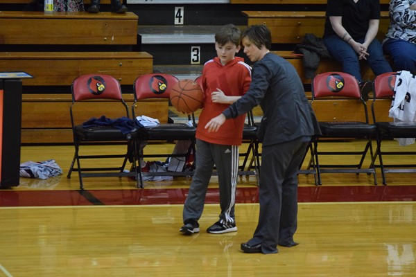 Monticello Elementary nurse Lindsey Sexton assisted 4th grader Braxton Gibbons who was randomly chosen to shoot a half-court shot trying to win $1000 from the Healthy Kids Clinic