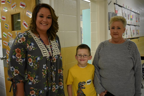 Teacher Jamie Spears with student Dakota Dishman and great-grandmother Julie Baker