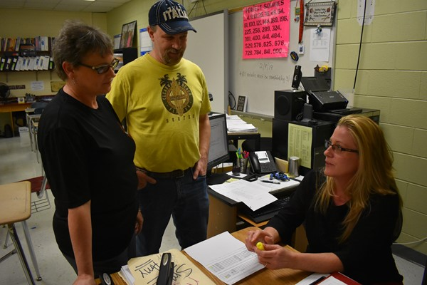 (L-R) Carol Skeese and her husband Johnny discuss their daughter Kaylee work with WCHS Math teacher Amy Weston