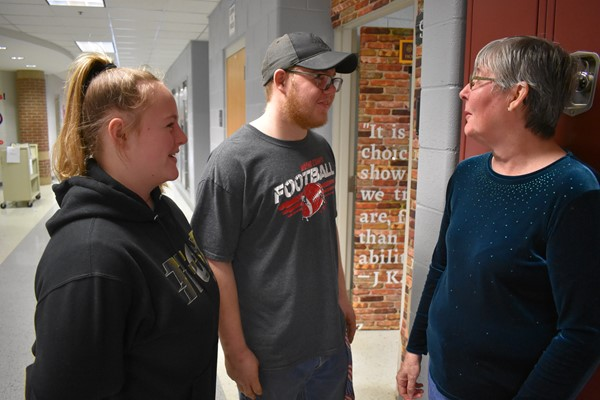 (L-R) Shelby Higgins and Sophomore T.J. Higgins speaking with Grandmother Anita Frye