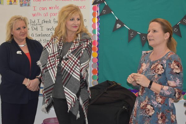 Board members (L-R) Whitney Smith and Donna Blevins listened to teacher Bonnie Barrier explain the Reading Recovery program