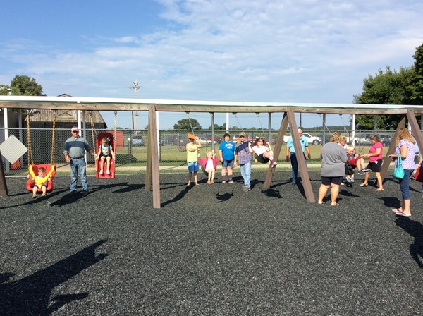 The playground was full of grandparents playing with students during Grandparents Week. The swingset was a major attraction.