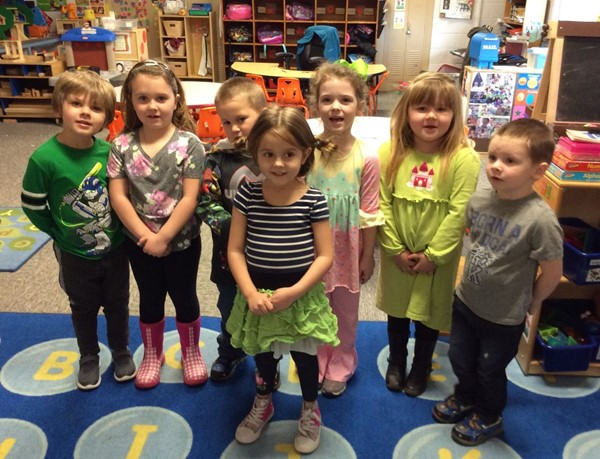 (L-R) Lucas Dillon, Adalynn Dobbs, David Lowe, Temperance Byler, Lily Bell, Jazmine Prince, and Tanner Pyles from Hellen Duncan's preschool orange class celebrating Green Eggs and Ham by wearing green