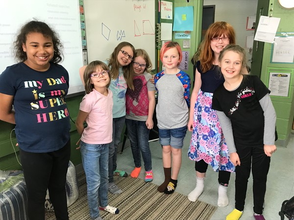 Monticello Elementary Teacher Miranda Cole's class show off their colorful and mix-matched socks
