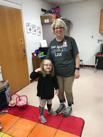 (L-R) Kayley Baker showing off her cool miss-matched socks with teacher Pam Brown