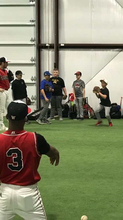 Future baseball players practice pitching with fellow Wayne County Baseball player, Tito Ruiz