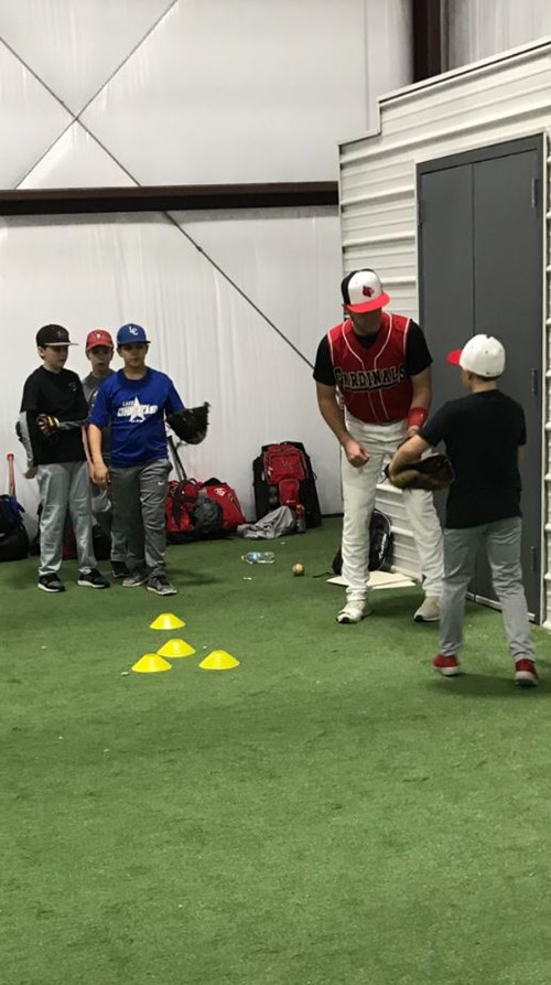 Young campers lining up to pitch