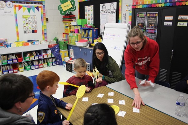 FBLA Member Nicole Hesse helping children with projects
