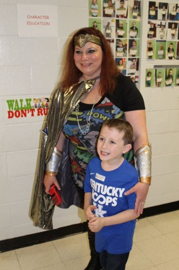 Principal Angela Ballinger with one of her student heros